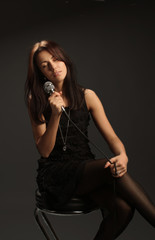 Singer with microphone elegant black dress portrait
