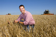 Farmer inspecting barley