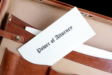 Power of Attorney document in a leather briefcase