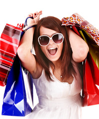 Girl in white glasses with shopping bag. Isolated.