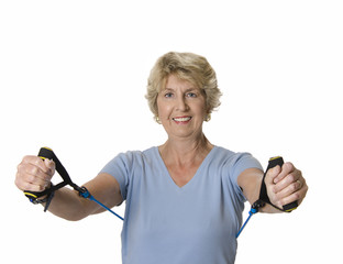 Senior woman using resistance band