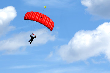 Extreme sports. parachuting under a blue sky