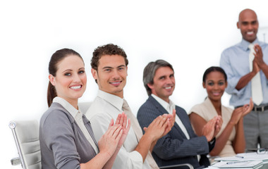 Confident business people clapping a good presentation
