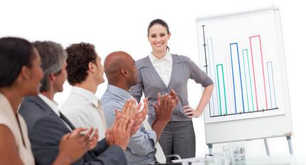 International business team applauding a good presentation