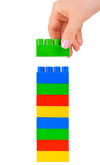 Hand and toy tower