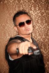 Hispanic Cop Pointing Gun