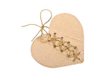 Torn cardboard heart with rope