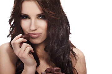 brunette girl in act to eat a chocolate