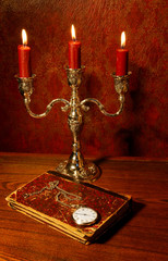 Old book, watch and  candelabra, focus on watch