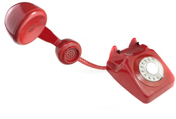Answering an old fashioned red telephone