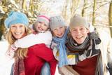 Fototapety Family Having Fun Snowy Woodland