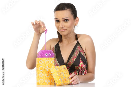 Beautiful girl taking the gift from gift box