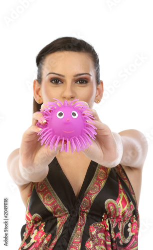 teenage girl showing pink soft toy