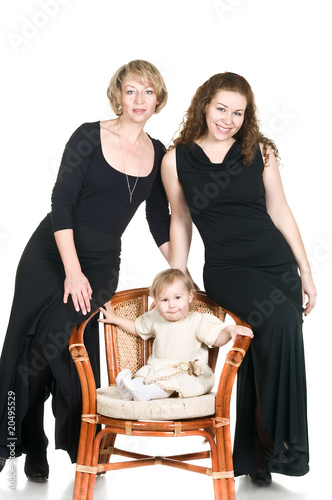 Mature grandmother, young mother and little daughter