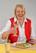 mature woman eating organic food and drinking