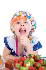 Putzfrau mit Lolly vor Obstteller