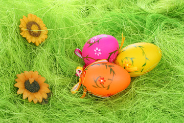 Painted Colorful Easter Eggs on green Grass.