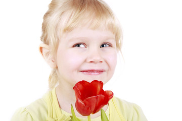 Little blond girl with tulip gift for mothers day