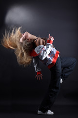 young woman modern dancer in action against black