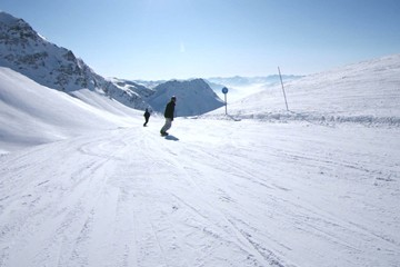 alpine skiing: going down a blue slope in French Alps