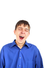 The yawning teenager isolated on the white