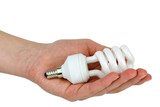 Hand holding compact spiral-shaped fluorescent lamp in hand