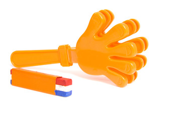 Orange accessories for Dutch soccer game over white background