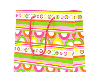 top of colorful shopping bag over white background