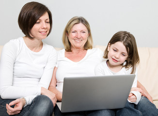Family of Three Generations using a Laptop