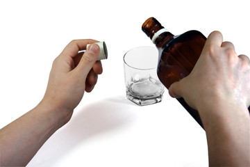 Hands with whiskey bottle