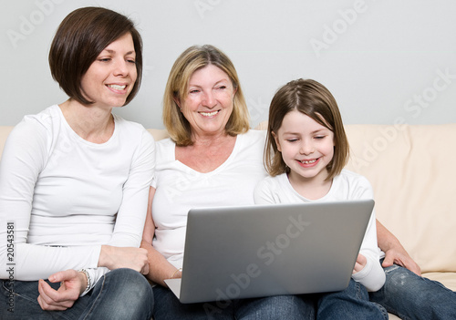 Shot of a Family of Three Generations using a Laptop