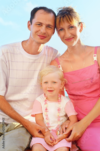 Happy family with little girl on beach, Parents hold  girl