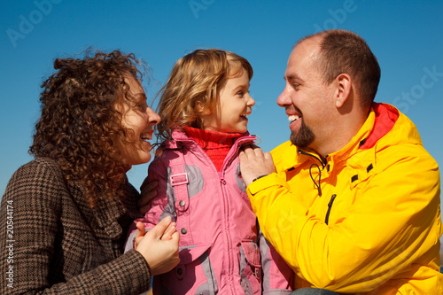 Portrait of happy family against blue sky