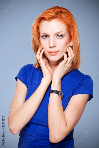 Beautiful girl with red hair in studio