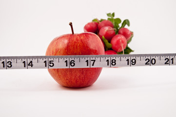 Red Apple, radish and a tape measure