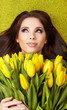 Woman with yellow tulip