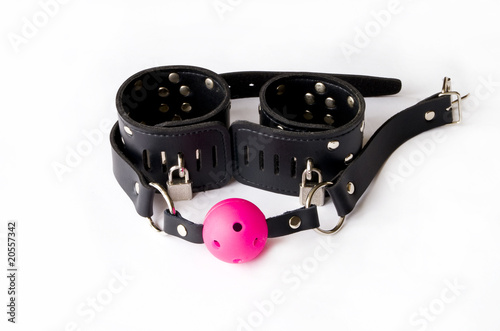 Gag and leather handcuffs.