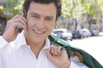 Man with shopping bags and phone