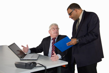 African-American senior manager instructing businessman