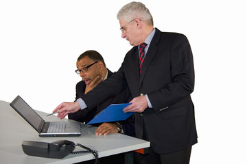 senior caucasian manager advising African-American businessman