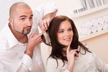 Professional hairdresser choose hair dye color at salon
