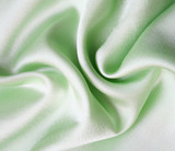 Smooth elegant green silk as background