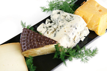 four type of cheeses on plate