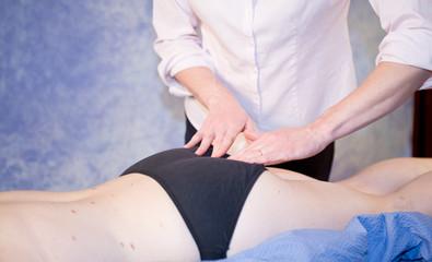 Chiropractor checking pelvis