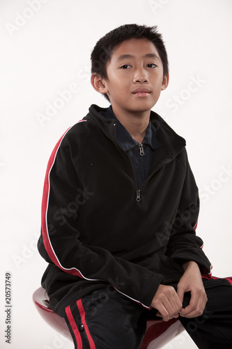 Young cute pre-teen asian boy