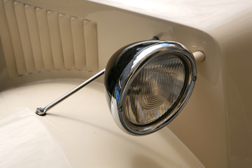 An old car's headlight.