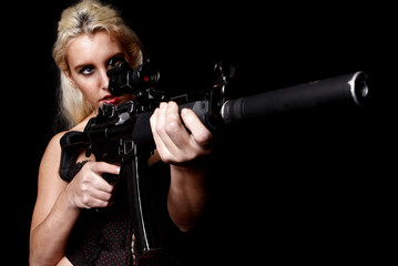 Blond woman with assault gun