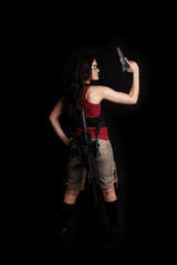 Sexy woman with rifle and pistol
