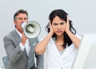 Competitive businessman shouting through a megaphone