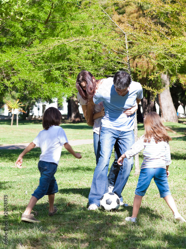 Lively family playing soccer